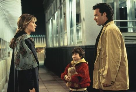 """This image released by 1993 TriStar Pictures, Inc. shows Meg Ryan as Annie Reed, left, Ross Malinger as Jonah Baldwin and Tom Hanks as Sam Baldwin, right, in a scene from """"Sleepless in Seattle,"""" a film written and directed by Nora Ephron. Ephron, the essayist, author and filmmaker who challenged and thrived in the male-dominated worlds of movies and journalism and was loved, respected and feared for her devastating and diverting wit, died Tuesday in Manhattan. She was 71. Born into a family of screenwriters, a top journalist in her 20s and 30s, then a best-selling author and successful director, Ephron was among the most quotable and influential writers of her generation. She wrote and directed such favorites as """"Julie & Julia"""" and """"Sleepless in Seattle,"""" and her books included the novel """"Heartburn,"""" about her marriage to Washington Post reporter Carl Bernstein. (AP Photo/1993 TriStar Pictures, Inc.)"""